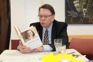 "Chancellor Rogers absorbed in ""Lean In"" by Cheryl Sandberg, one of the books studied at Dr. Eagly's workshop."