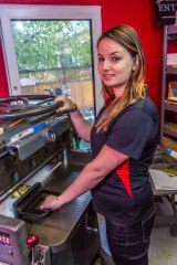 Suzie Avant working at Interior Graphics & Printing.